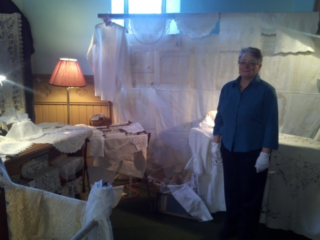 Our wonderful volunteer Sharon with some of the Heirloom stitching!